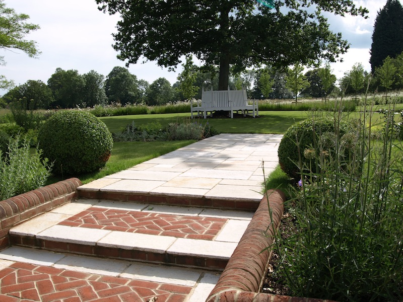 We create brick panels in the wide steps to add interest