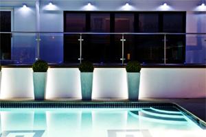 Pool with lighting in Brighton garden